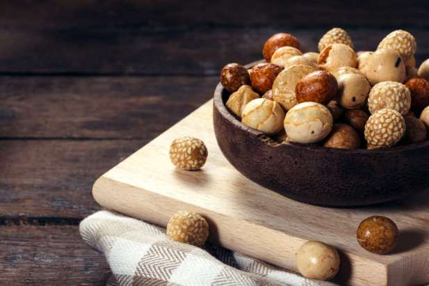 Asian mix with peanuts on the wooden background,selective focus
